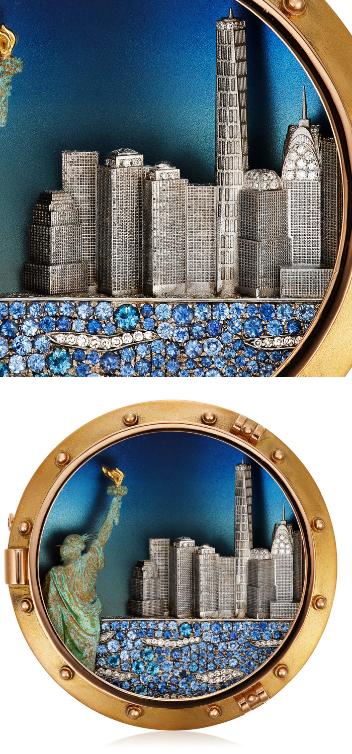 NYC brooch by Michele della Valle showing the New York City skyline and the Statue of Liberty. In titanium and copper with diamonds, sapphires, and gold.