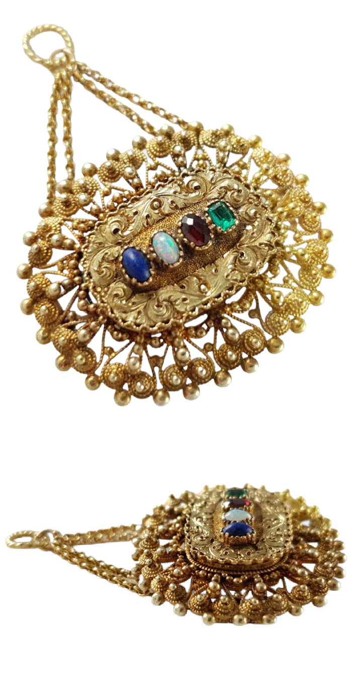 This Georgian era acrostic jewel features lovely gold cannetille work and gemstones that spell 'LOVE.' From Argentum Antiques & Collectables on 1st Dibs.