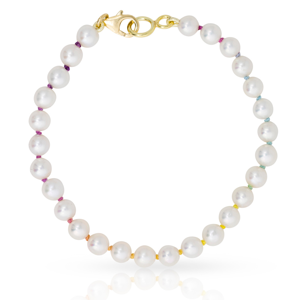 This rainbow pearl bracelet from Mined + Found features hand-knotted freshwater pearls on rainbow silk.