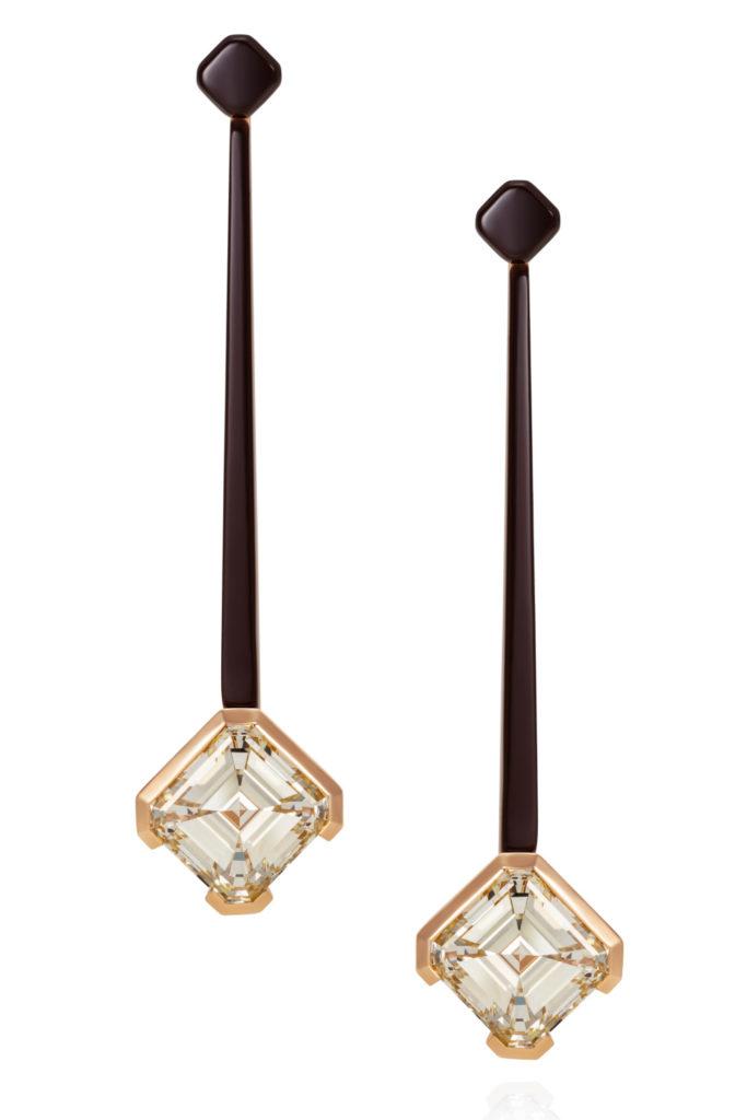 Diamond earrings by Thlema West, with two asscher cut diamonds on black ceramic earrings.