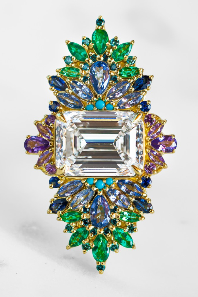 The Peacock ring by Maggi Simpkins. With a 10.13 ct emerald cut diamond, sapphires, emeralds, and blue diamonds. Incredible!
