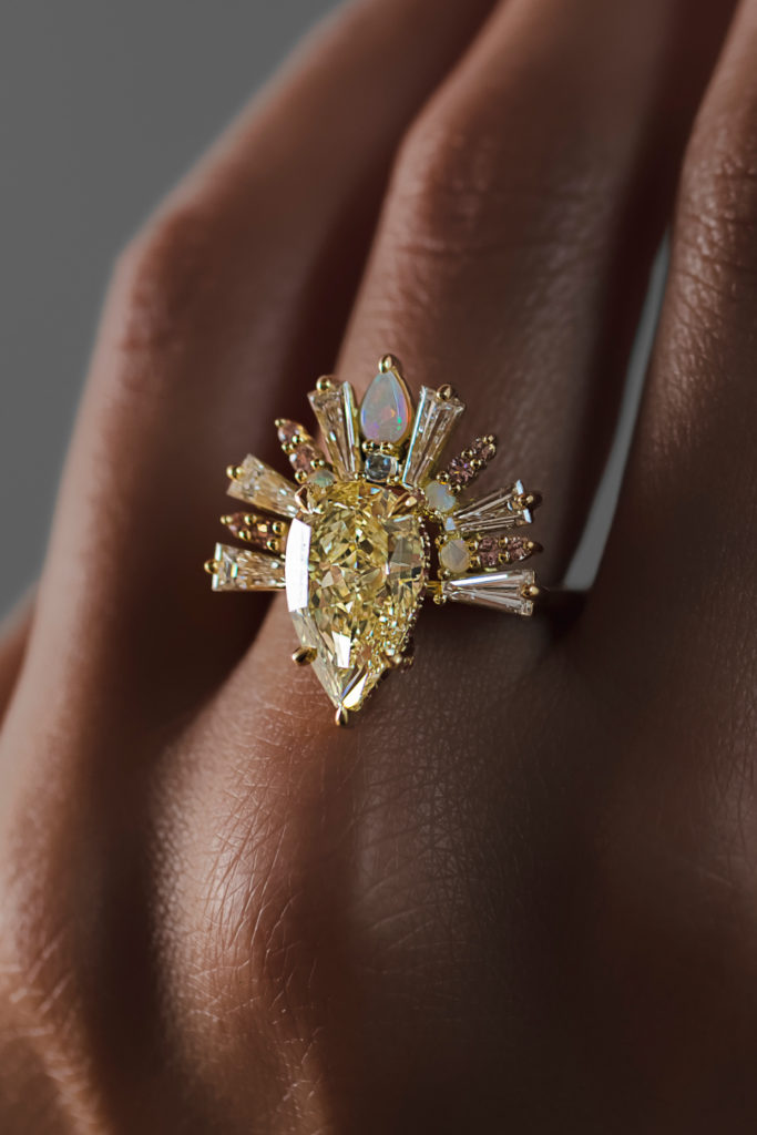 The beautiful Sunburst ring by Maggi Simpkins, with a pear-shaped yellow diamond, baguette diamonds, moonstone, peach sapphires and pink tourmaline