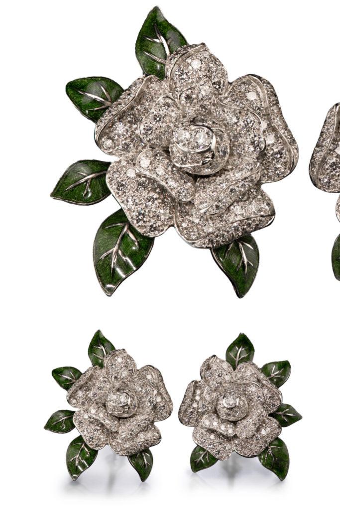 Oscar Heyman earrings in the shape of gardenia flowers, with diamonds and enamel. From Tiina Smith.
