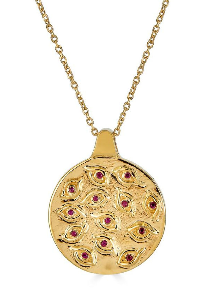 The Argus eye medallion from KIL NYC's Teras Collection. In gold with rubies, inspired by the Greek myth of Argus.