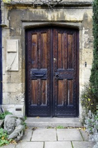 Downton Abbey and Blended Families Wooden door in stone building England www.dianabrandmeyer.com