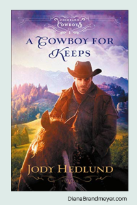 Mountains in the background, man wearing a cowboy hat sitting on a brown horse with a white strip done it's face
