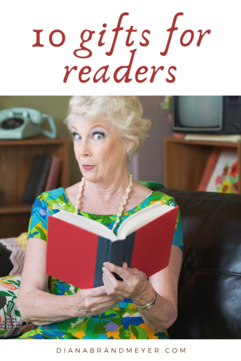 10 gifts for readers older woman reading a book wearing pearls looking surprised