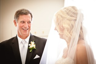 Father smiling at bride at st luke's chapel in charleston