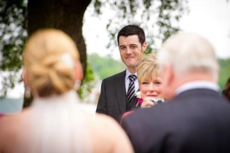Groom sees his bride walking down the aisle (2)