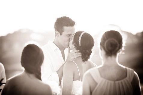 backlit bride and groom kiss on kiawah