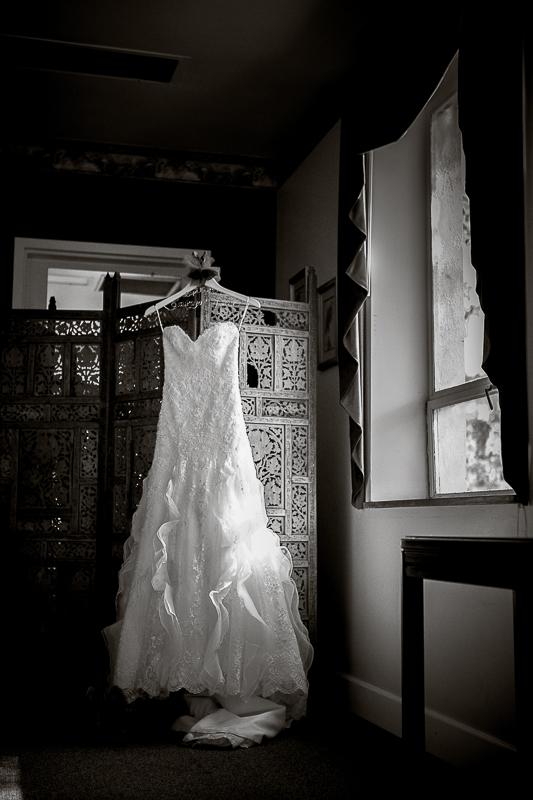 black and white wedding dress in window light