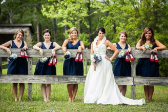 bride and bridesmaids holding shoes
