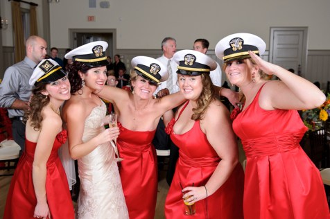 bride and bridesmaids wearing navy hats