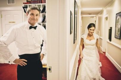 bride and groom hidden from each other in door way