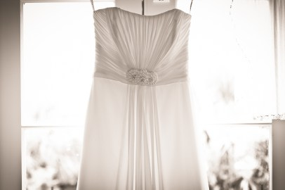 bride dress hanging in window