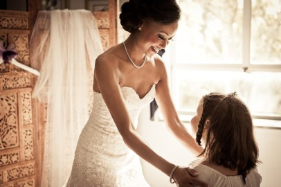 bride smiling at little girl