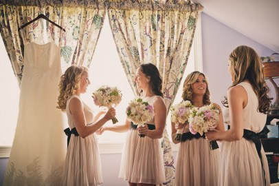 bridesmaids holding bouquets