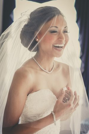 smiling veiled bride