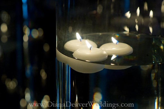glass, flowers and candles wedding decorations captured by wedding photographer Diana Deaver in Charleston SC-3