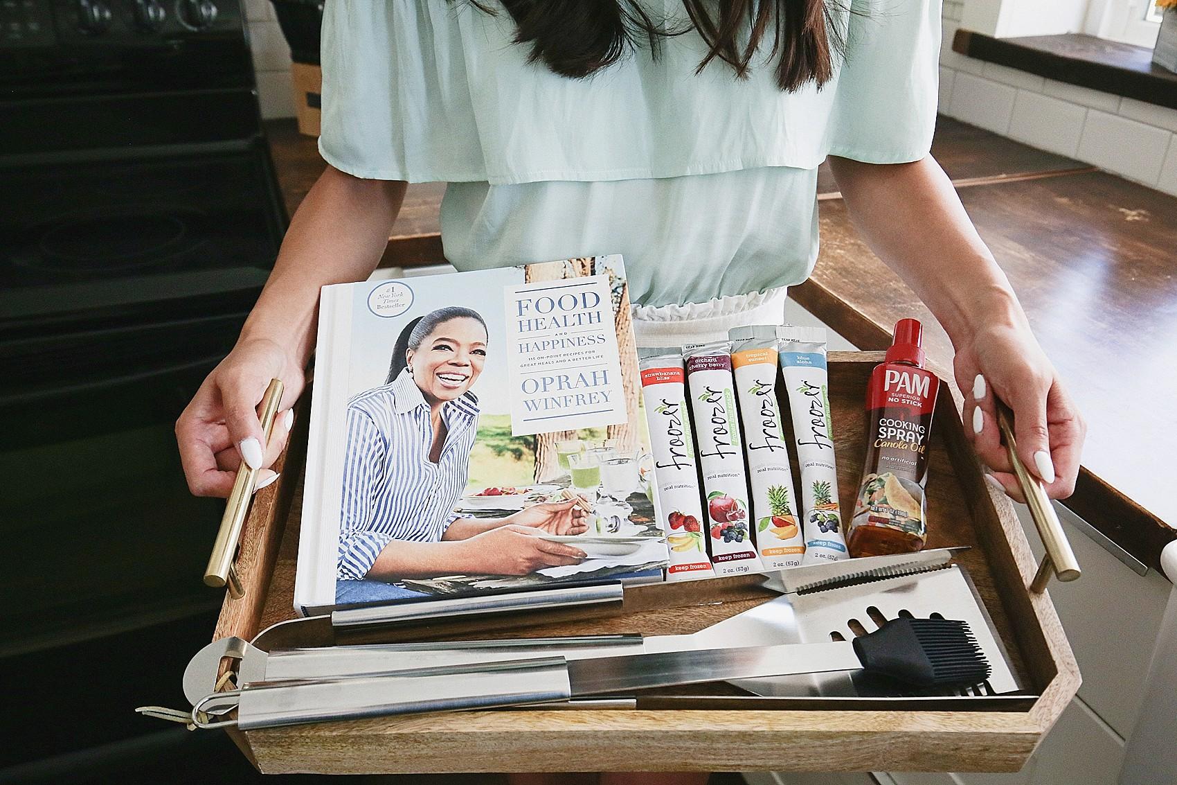 Diana Elizabeth Blogger phoenix lifestyle blogger holding tray with outdoor entertaining goodies