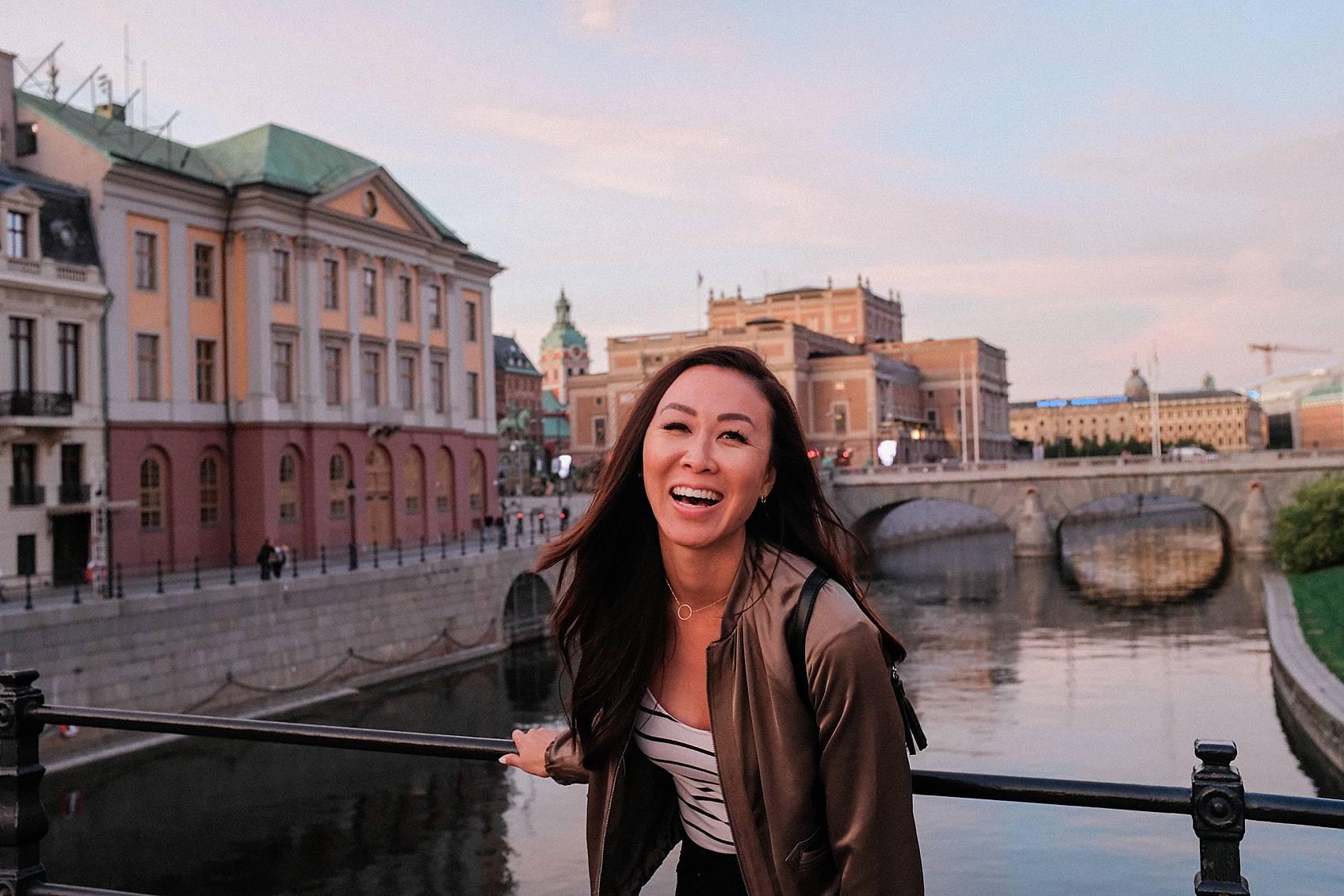Photo tour of Stockholm: walking around laughing at bridge at sunset