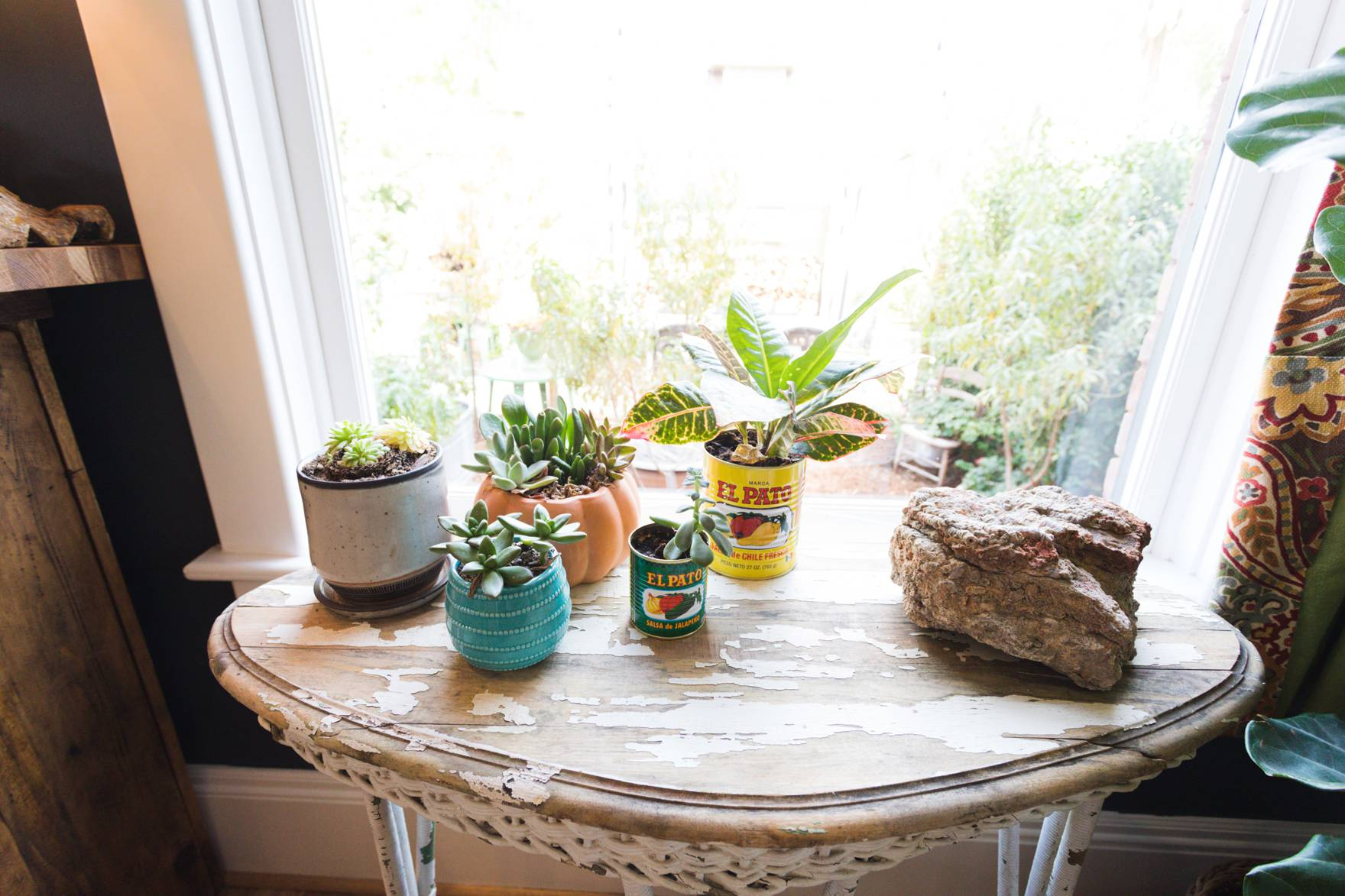 Home Tour of Boho Farm and Home in Downtown Phoenix - cottage brick style home from 1903 living room to kitchen details succulents in old sauce jars
