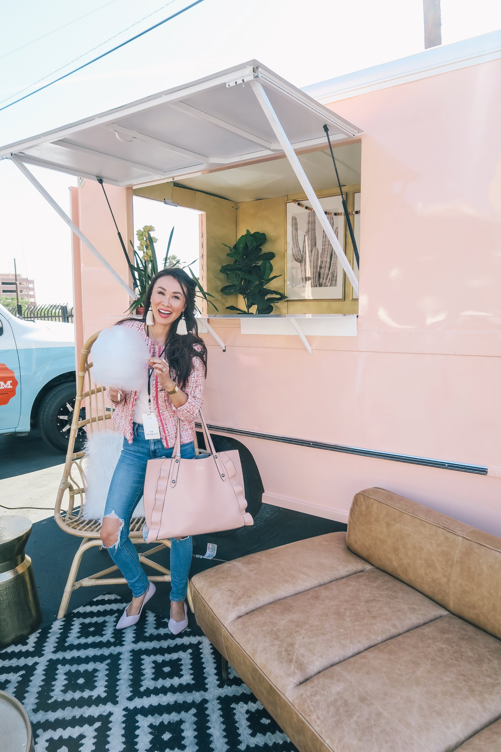 standing by the peach az restored truck in pink boucle jacket ripped jeans and holding cotton candy // a business and blogging social media workshop called The Workshop PHX by the Bloguettes - a review.