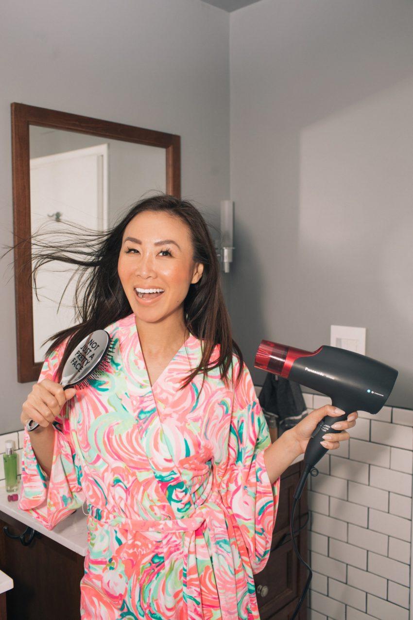 Featuring Panasonic nanoe™ hair dryer wearing pink robe