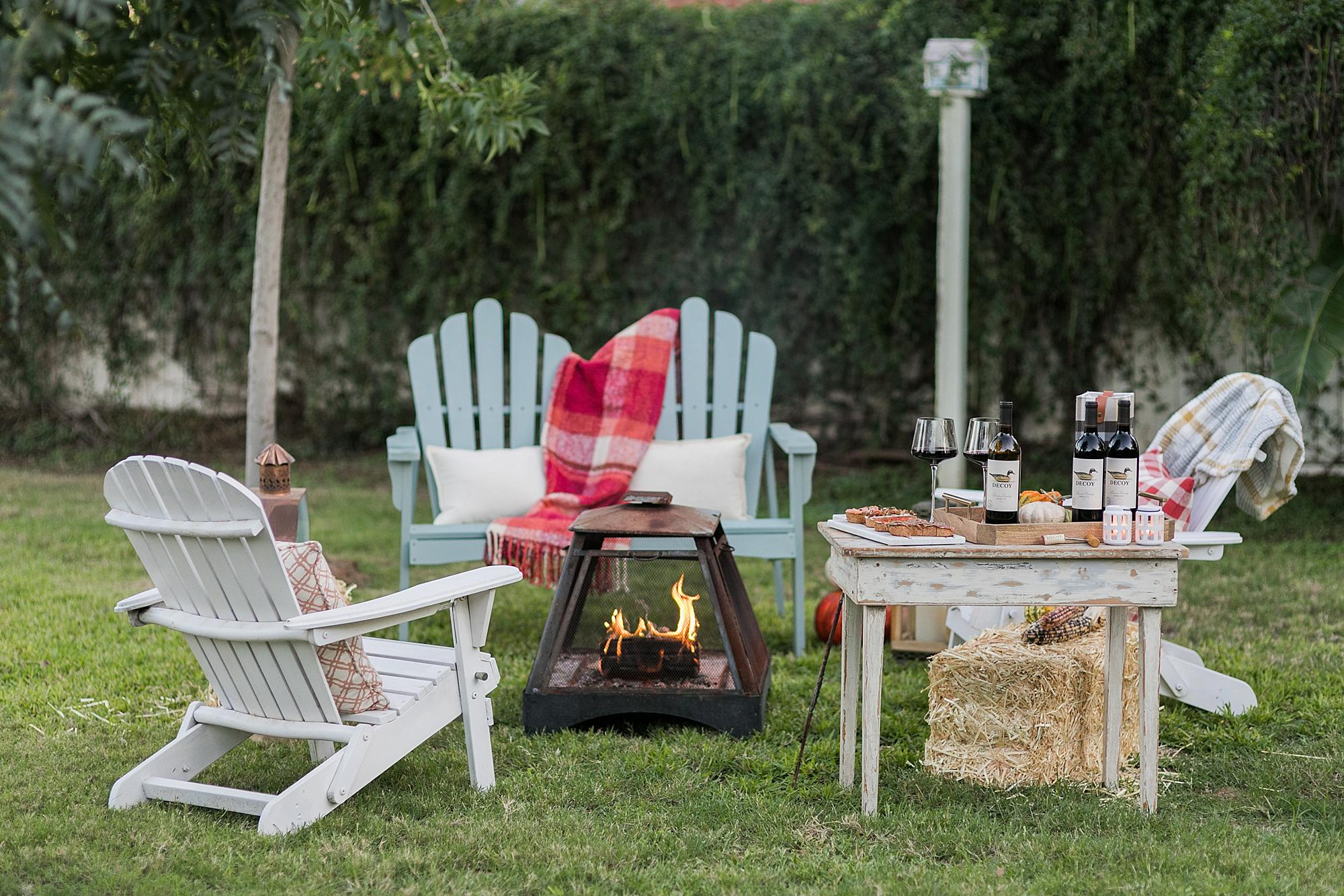 fall backyard gathering party outdoors with decoy wine merlot for October merlot month #wineparty #wine