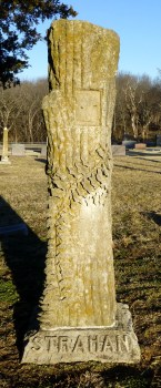 The Strahan Family tree stump, honoring A.J. Strahan (1835-1915), Mary Strahan (1845-1905), and Charles Strahan (1869-1899).