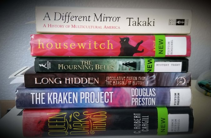 Photograph of books on my nightstand to read in  May and June 2015