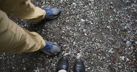 photograph of two pairs of shoes on a rocky trail