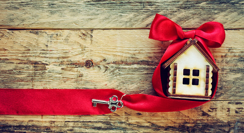 small house with red ribbon and key