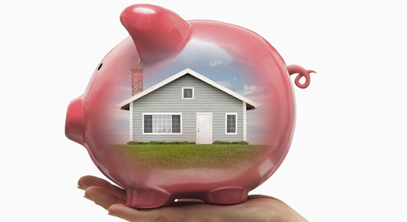 House reflected in piggy bank