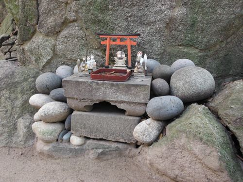 A little shrine for cats, just at the right hight for cats to sit in front of it.