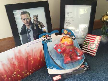 Jennifer's gifts: two photo frames with pictures of her favourite actor and quotes of her favourite movie, plus a super hero Mr Potatohead.