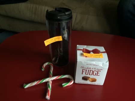 Kai's gifts: a travel mug, Russian fudge, two candy canes.