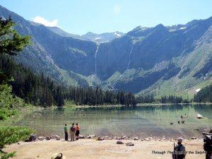 Avalanche Lake with high waterfalls in the distance