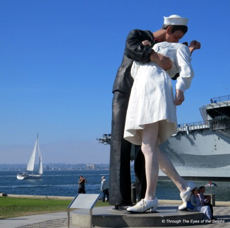 Unconditional Surrender is a three-dimensional interpretation of a photo taken by Alfred Eisenstaedt of a Sailor kissing a nurse in Times Square, New York City on Aug. 14, 1945, following the announcement of V-J Day.