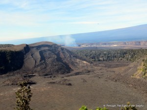 Kilauea Iki Crater with Halemaumau Crater emitting gas plume in the distance