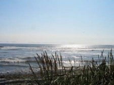 Straight of Juan de Fuca Beachfront at Jordan River, BC 60km NW of Victoria looking towards the Olympic Peninsula in NW Washington State, USA