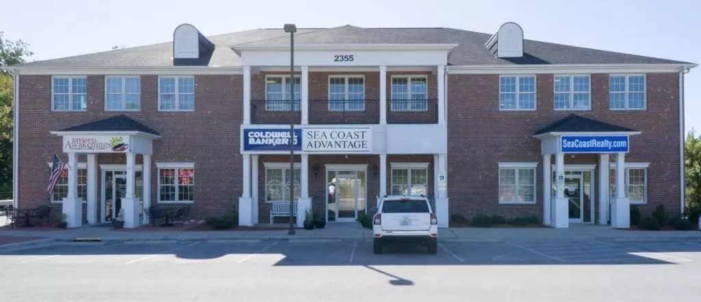 commercial building that houses Castro Real Estate Group and Coldwell Banker Sea Coast Advantage