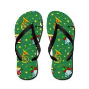 Christmas Horns and Bells against a green background Flip Flops
