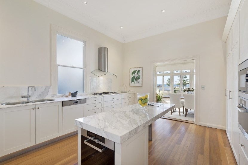 The kitchen is beautiful in pure white marble
