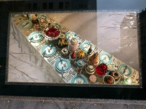 Tiffany's has the challenge of catching your eye with small pieces of jewelry rather than full-size mannequins and grass gorillas. In this window, each plate on the dining table has an exquisite piece of jewelry.