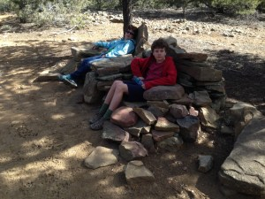 Relaxing at the summit in a grove of pinon and juniper trees.  Someone built these Adirondack chairs from rocks.  The chairs were a bit chilly, but we didn't mind.