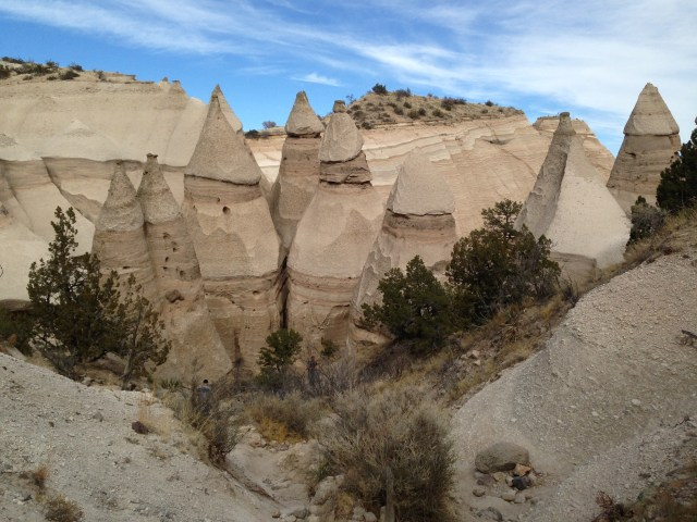 "Some of the so-called ""tent rocks."" Millions of years ago, volcanic eruptions left a 1000-foot thick layer of pumice, ash and tuff deposits, which have gradually eroded to form these conical hoodoos and other formations."