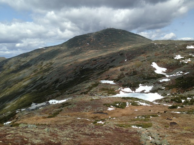 View of Mount Washington and one of the still-ice covered Lakes of the Clouds.