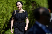 Huawei Technologies Chief Financial Officer Meng Wanzhou leaves her home to attend a court hearing in Vancouver, British…