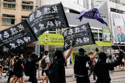 An anti-national security law protester holds a Hong Kong independence flag as he marches at the anniversary of Hong Kong's…
